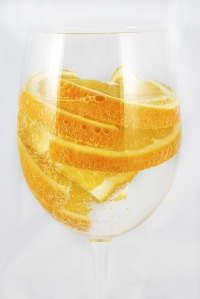 Glass of water with oranges